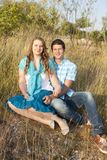 Loving couple in the grass Royalty Free Stock Photography