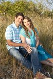 Loving couple in the grass Stock Photos