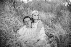 Loving couple on grass in summer stock photo