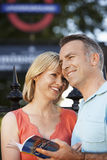 Loving Couple With Guidebook Outdoors Stock Photos