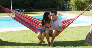 Loving couple in hammock kissing each other Royalty Free Stock Photo