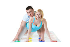 Loving couple have fun with Twisting game Stock Photo