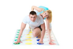 Loving couple have fun with Twisting game Stock Image