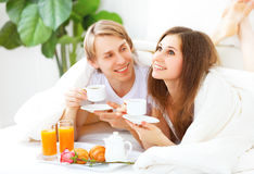 Loving couple having breakfast in bed Royalty Free Stock Photos
