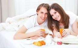 Loving couple having breakfast in bed Royalty Free Stock Photo