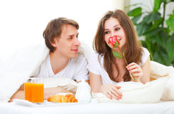 Loving couple having breakfast in bed Stock Images