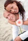Loving couple having fun on the beach Stock Images