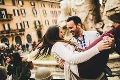Loving couple having fun in Rome, Italy
