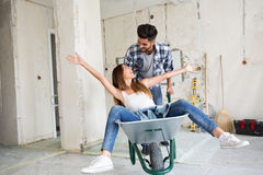 Loving couple is having fun while they are renovating house. Loving couple is having fun while they are renovating home Stock Images