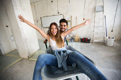 Loving couple is having fun while they are renovating house. Loving couple is having fun while they are renovating home Royalty Free Stock Photography