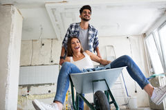Loving couple is having fun while they are renovating house. Loving couple is having fun while they are renovating home Stock Photos