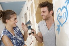 Loving couple having fun at renovation Royalty Free Stock Image