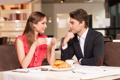 Loving couple having romantic breakfast at the restaurant. Stock Photo