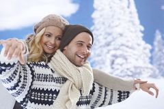 Loving couple having winter fun Royalty Free Stock Image
