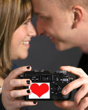 Loving couple holding camera Royalty Free Stock Photography