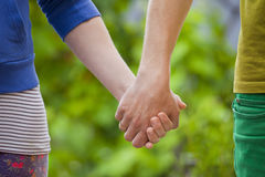 Loving couple holding hands Royalty Free Stock Photos