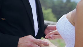 Loving couple holding hands with rings. HD stock footage