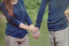 Loving couple holding hands Royalty Free Stock Photo