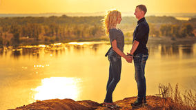 Loving couple holding hands at sunset. Stock Image