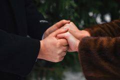 Loving couple holding hands with wedding rings. Closeup Stock Images