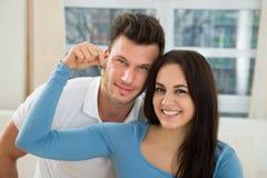 Loving couple holding house keys Stock Photography