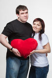Loving couple holding large red heart at hands Stock Photo