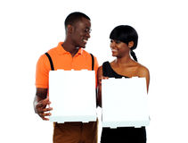 Loving couple holding pizza boxes Royalty Free Stock Photography