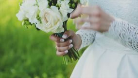 Loving couple holding a wedding bouquet in hands.  stock video