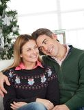 Loving Couple At Home During Christmas Royalty Free Stock Photo