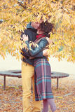 Loving couple hugging in autumnal park Royalty Free Stock Images