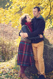 Loving couple hugging in autumnal park Stock Photo