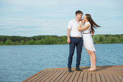 Loving couple hugging on the bank of the river Royalty Free Stock Photo