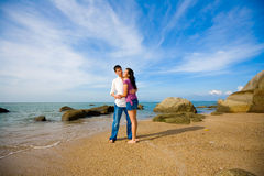 Loving couple hugging each other. Loving happy couple hugging each other on the beach during summer time with blue sky Stock Photo