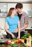 Loving couple hugging in the kitchen Stock Image