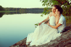 Loving couple hugging on the lake. Beauty young woman and man in Stock Photo