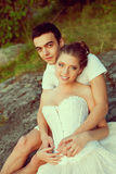 Loving couple hugging on the lake. Beauty young woman and man in Royalty Free Stock Photography