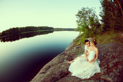 Loving couple hugging on the lake. Beauty young woman and man in Royalty Free Stock Photos