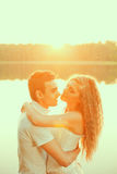 Loving couple hugging on the lake. Beauty young woman and man in Stock Image
