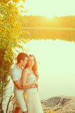 Loving couple hugging on the lake. Beauty young woman and man in Royalty Free Stock Image