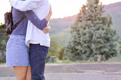 Loving couple hugging strong outdoors with no faces shown. Roman Royalty Free Stock Images