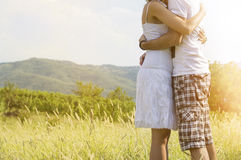 Loving couple hugging strong outdoors with no faces shown stock images