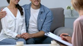 Loving couple hugging and talking at family psychologist therapy session, trust. Stock footage stock video footage