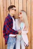 Loving couple hugs against fence Stock Image