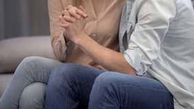 Loving couple interlacing their fingers, strong relations, intimate moment. Stock photo stock image