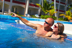 Loving couple in jacuzzi. Stock Photo