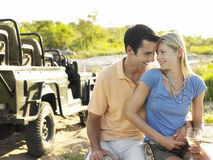 Loving Couple With Jeep In Background Stock Photo