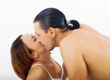 Loving couple kissing   in bed Stock Photography