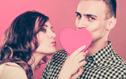 Loving couple kissing behind red heart. Love. Royalty Free Stock Images