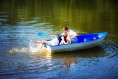 Loving couple kissing in the boat. Summer vacation concept. Stock Photo