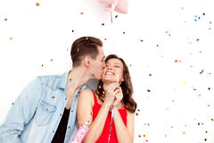 Loving couple kissing in confetti Royalty Free Stock Photo